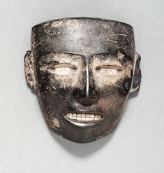 The masks of prehistoric and ancient Mexico through time. Mask with Inlaid Teeth. Mexico, Basin of Mexico, Teotihuacan, Teotihuacan, 200-600. Stone with shell inlay. AC1996.146.50.