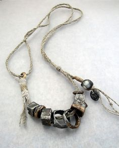 the spirit and creativity of kathy van kleeck | epic Cubes - steel with bronze overlays on linen cord with a Basha bead | [[MORE]]