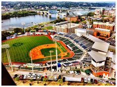 aerial shot of riverfront Chattanooga, which includes the baseball field (The Lookouts Stadium) Chattanooga Mocs, Chattanooga Choo Choo, Chattanooga Tennessee, Great Places, Places To Go, Baseball Park, Baseball Shirts, Baseball Field, Outdoor Magazine