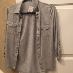 forever 21 button up shirt forever 21 button up shirt ..gray great condition:) Forever 21 Tops Button Down Shirts
