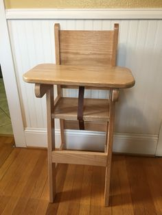 """High chair with adjustable tray. 36"""" tall. Tray support is 29"""" high. Tray is removable and leather strap snaps on and off"""