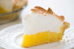 Mile high lemon meringue pie! Tart and creamy lemon custard filling with a billowy meringue top. On SimplyRecipes.com