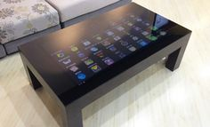 Very nice four leg coffee table with smooth glass top featuring a HD capa. New Technology Gadgets, Smart Home Technology, High Tech Gadgets, Gadgets And Gizmos, Cooking Gadgets, Futuristic Technology, Electronics Gadgets, Smart Desk, Smart Table