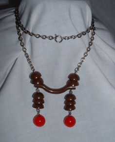 Egyptian Modernist Necklace by Bengel German 1930's orange and brown galalith and chrome necklace.