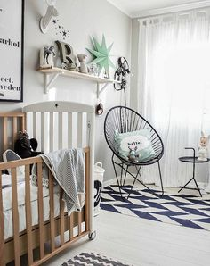 Gender neutral nursery ideas we love: Graphic elements.  Bring them into your baby's room with a rug or pillow.