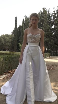 For bride's who want to make a unique statement our is tailored to perfection. This jumpsuit is constructed of a sheer tulle corset with a delicate floral embroidery and a high-waisted satin trouser with a satin overskirt completed with a metallic belt. Wedding Robe, Wedding Pantsuit, Dream Wedding Dresses, Wedding Attire, Wedding Gowns, Womens Wedding Suits, Bridal Outfits, Bridal Dresses, Prom Dresses