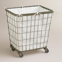 """Ellie Rolling Hamper from World Market. Vintage in style, this hamper is made of metal in an antique finish. Features a removable polyester liner, and casters that allows it to roll easily from room to room, making laundry time a little simpler. 20""""W x 15""""L x 23""""H. $99.99"""