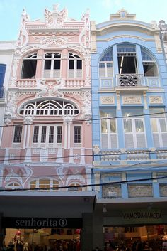 These are two buildings in Recife, Brazil.  I love the detail of these buildings.  A different detail catches one's eye each time they look at it.  I love the unique colors that allow these buildings to stick out.