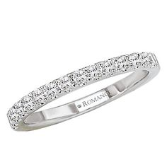 A diamond wedding band that will stand the test of time This straight line prong set diamond band shows .04 carat size diamonds in the most brilliant way