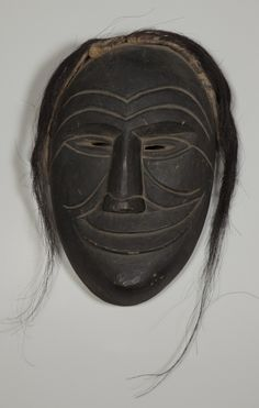 Iroquois Mask. Canada, Ontario, Grand River Reservation. height with hair 40.64 cm, mask only 34.29 cm. 19th Century