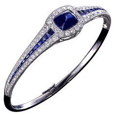 Art Deco platinum, star sapphire cabachon and diamond bangle bracelet Sapphire Bracelet, Sapphire Jewelry, Diamond Bangle, Diamond Jewelry, Diamond Brooch, Crystal Jewelry, Silver Jewelry, Edwardian Jewelry, Antique Jewelry