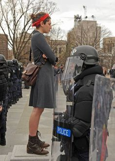 THIS GIRL.     At a protest in favor of reproductive rights in Richmond VA, Mara Hyman, faces down cops in riot gear.  33 people refused to leave the steps, and were arrested. Protester, identified as Mara Hyman, faces down cops in riot gear.