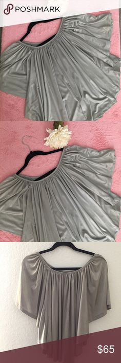 SILVER TUNIC 🎄 Beautiful Silver Poncho Blouse. Perfect for Christmas 🎄. 💗Condition: EUC, No flaws 💗Smoke free home 💗No trades, No returns 💗No modeling  💗Shipping next day 💗OPEN TO reasonable OFFERS  💗BUNDLE and save more 💗All transactions video recorded to ensure quality. Urban Outfitters Tops Tunics
