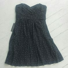 """NWT polka dot georgette dress 6P NWT petite polka dot georgette strapless dress. Hidden side zipper with hook and eye, inside bustier, fully lined. 6 Petite. Style #325335, from the bridal/ events collection. Appx measurements: 16"""" bust laid flat, 15"""" waist laid flat, 22"""" waist to hem, 30"""" total length highest part of cup. No flaws. Will model on request. Make an offer!!!!! Ann Taylor Dresses Strapless"""