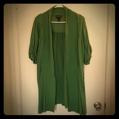 Green full length shrug Green and soft this is a great pairing with tank tops and perfect for St.  Patrick's Day! Medium wear. Lane Bryant Tops Blouses