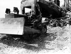 This bulldozer driven by a member of the Army Service Forces helps clear rubble at the Cherbourg Harbour Station, 27 june 1944 Caterpillar D4, Normandy Invasion, Landing Craft, History Online, D Day, Armored Vehicles, Heavy Equipment, Us Army, World War Ii