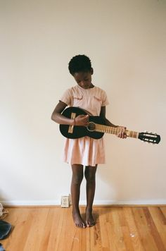 . Young girl playing a guitar. #music #youth #kids #musicalyouth http://www.pinterest.com/TheHitman14/musical-youth-%2B/