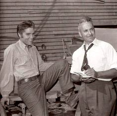 Elvis with a member of the movie production in september 1956.