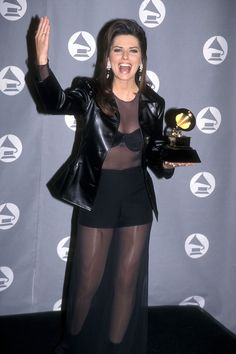 "Shania Twain career retrospective : First Grammy Win. Shania's The Woman in Me album had hit songs like ""Whose Bed Have Your Boots Been Under?"" ""Any Man of Mine,"" and ""I'm Outta Here!"". It earned the singer a Grammy award for Best Country Album in 1996. By this time, she has already won, CMT - (Europe): Rising Star and Canadian Country Music Association Awards (CCMA's): Album of the Year (The Woman in Me) as well as Female Vocalist of the Year besides other accolades."