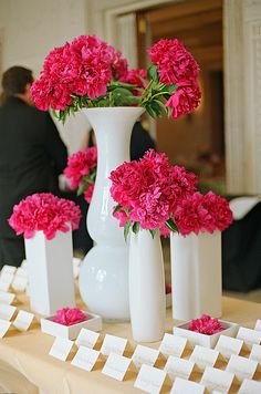 A pop of pink on the escort card table #weddings #escortcards #blisschicago