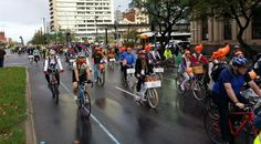 """Velo-City delegates go for a ride around town - note the inflatable orange """"helmets"""" worn by the Dutch..."""
