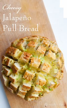 Cheesy Jalapeño Pull Bread! So easy to make, all you need is a large rustic bread loaf and some pepperjack (Monterey jack cheese and jalapeños) and green onions. Fun appetizer for a crowd. Your guests will love it! #GameDay #SuperBowl On SimplyRecipes.com