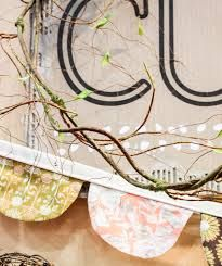 """A snippet from the booth we decorated for Bonnie's new fabric line, """"Cultivate""""."""
