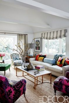 Minnie Driver's home features a 50s French bergère covered in a Lee Jofa floral and vintage French armchairs that are upholstered in a 1960s suzani.