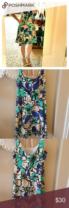 Nine West Blue and Tan Sundress This Nine West Blue and Tan Sundress is fully lined and has fasteners on the inside of the straps to hold a bra in place. Nine West Dresses Mini