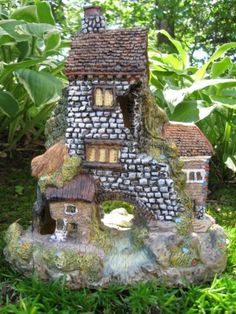 """Blackthorn Fairy House by Market Hill. $27.95. Can be used in indoor container gardens or in outdoor fairy garden. Perhaps the fairies who live here go down the front path and catch fish for dinner?. Resin Blackthorn Fairy House is approx 6"""" x 7 1/2"""" is weatherproof. Charming 2 story brick Blackthorn Fairy House with a stream has several doors, windows and chimeys. Great fairy house for seasonal fairy gardens.....Halloween, Christmas or anytime!. A great smaller..."""
