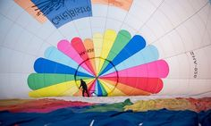 Ocseny, Hungary. A crew member prepares a hot air balloon for takeoff during the 28th international annual meeting