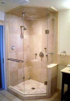 Space saver. Corner walk in shower with knee wall to make the space more open and feel larger with neo angle frameless heavy glass shower door. Just as functional as a larger shower without the extra space. Tile ceiling to finish it off!