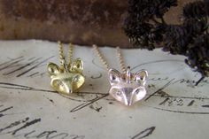 A cute #FoxPendant set with tiny diamonds for eyes in #GoldVermeil by Alexis Dove