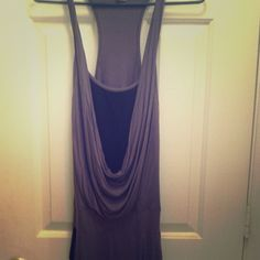 Body Central. Cowl-neck, racerback tank dress Really cute dress! Has attached ribbed black shirt & side pockets. Banded hem hits right above the knee. body central Dresses