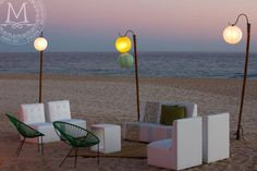 Set up @ the Beach - White leather sofas, colorful cushions, green Acapulco chairs and paper lanterns lights: Less is more!