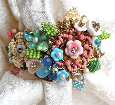Exquisite Lilygrace Pastel Floral Handwired Antique Brass Cuff with Vintage Rhinestones and Vintage Miriam Haskell Glass Flowers. $135.00, via Etsy.