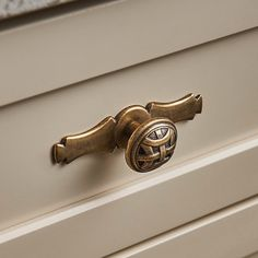 Look familiar? The Celtic Large Knob is the inspiration for our logo and part of the Top Knobs Tuscany collection. Inspired by architectural details of Italian villas the suite of knobs and pulls creates an authentic look in the heart of the home.  Pictured: Celtic Large Knob 1 1/4 Inch (M160) in German Bronze finish.  #topknobs #tuscany #decorativehardware #cabinethardware #kitchen #celticknot #topknobshardware #topknobsusa #bronze #cabinetknobs #knob #topknobs