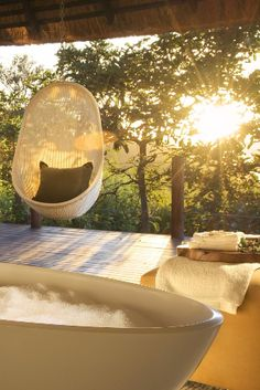Stylish bathrooms have freestanding soaking tubs and rain showers. Lion Sands Sabi Sand (South Africa) - Jetsetter