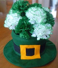 DIY Leprechaun Hat Table Decoration — Leprechaun Hat Floral Centerpiece from Craft Elf is made from felt. Free printable instructions are provided.