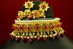 JADAVI LACHCHA - example of the richness and craft of traditional Indian style jewelery. This neck parure and earrings set is part of the Hydabad's Nizam(Moghul kings living in India) Crown Jewels. these pieces are adorned with Indian Burmese rubies, natural pearls mounted in 18 kt gold.