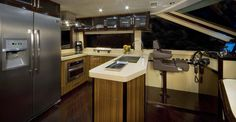 Lazzara 76 :: Check this out - Keep an eye on your cooking while navigating the boat. Now that's living!