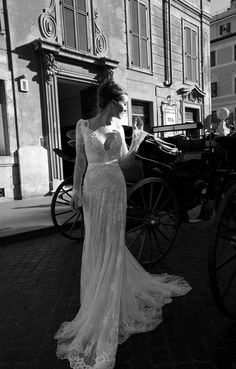 A little too low cut but other than that I loveeeee this! Lace long sleeved wedding dresses are so classic