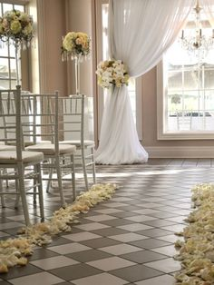 indoor wedding ceremonies | Indoor Wedding ceremony aisle decorations The flowers on chandeliers could double up as centre pieces!