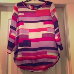 Adorable geometric print top Cute purple, pink and cream top with gold buttons in sleeves. Lovely by itself or with cardigan. Tops