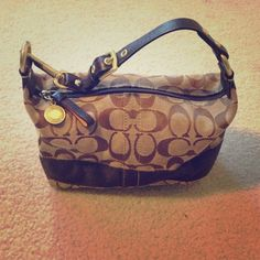 Tiny Coach purse. Really good shape. Teeny tiny Coach purse. Really cute for going out on the town. Holds more than a wristlet but doesn't take up much more space. 8 inches wide by 4 inches tall. Coach Bags