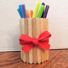 """My daughter has made these Popsicle / craft stick pencil holders as end of the year teacher gifts the last two years and was very proud to see that her kindergarten teacher still uses it. This also makes a great """"back to school"""" craft, whether your child goes to school outside the home or..."""