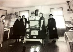 Homemakers touring remodeled kitchens in 1936.