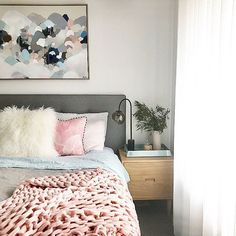 Adding color to a room is simple. Art and throw blankets can make all the difference.