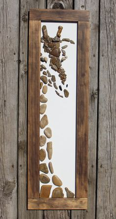Hello Giraffe was created with rocks from the eastern banks of Lake Michigan. Each rock was handpicked, cleaned, prepared and chosen for this particular piece of artwork. The frame was built specifically for this piece and is secured to the artwork. It has hanging wire attached to the back so it is ready to hang! The outside of the frame measurements are: 13w x 43.25h