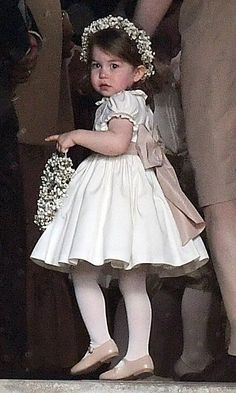 Prince William and Kate Middleton's daughter Princess Charlotte was adorable bearing flowers with a matching garland in her hair. Photo: Getty Images